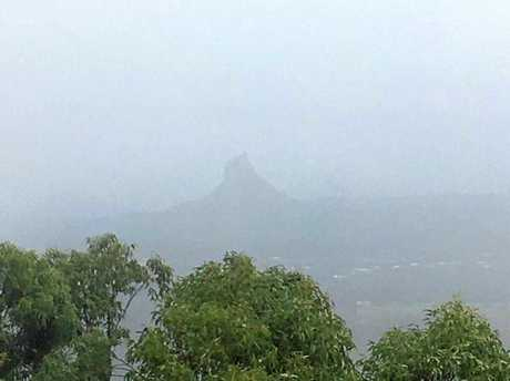 Wet weather has made for some not-so-scenic views overlooking the Glass House Mountains from Mt Mellum.
