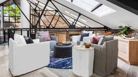 The light-filled warehouse renovation sprawls across two levels. Picture: Supplied