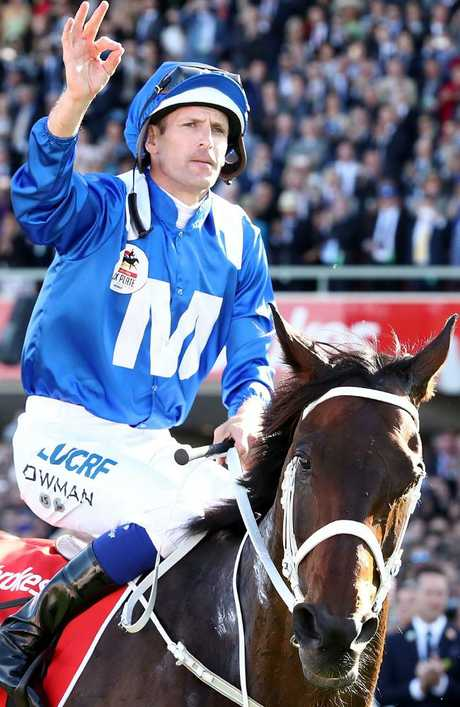 """Hugh Bowman gives his familiar """"she's apples"""" salute after Winx wins her third Cox Plate at Moonee Valley last spring. Picture: Getty Images"""