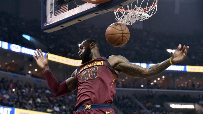 LeBron James dunks.