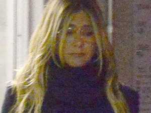 Glum-looking Aniston steps out following split