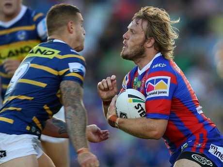 Cameron King tackles Nathan Ross.