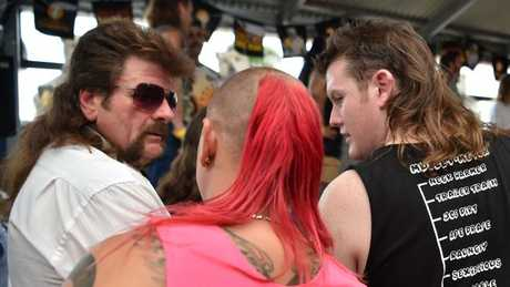 Serious mullet action: Men wait to be judged on their mullet styles at Mulletfest. Picture: AFP/Peter Parks