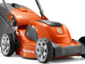 Woman 'pinned' under ride-on lawnmower