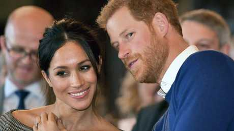 Britain's Prince Harry with bride to be Meghan Markle as they watch a dance performance by Jukebox Collective during a visit to Cardiff, Wales. Picture: Ben Birchall/Pool via AP.
