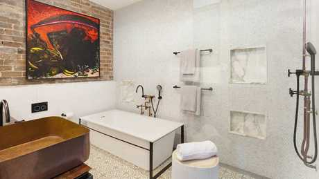 The bathrooms feature wood, copper and marble. Picture: Supplied