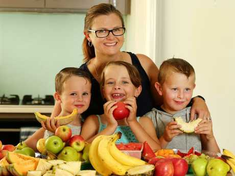 Xavier, 3, Summer, 8, and Zac, 6, with mum Katrina Volkerts all love munching on fruit and eat it multiple times a day. Picture: Andrew Tauber