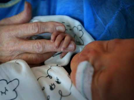Tiny Harvey Morrison is cuddled by Diane Haydon. Picture: Jamie Hanson