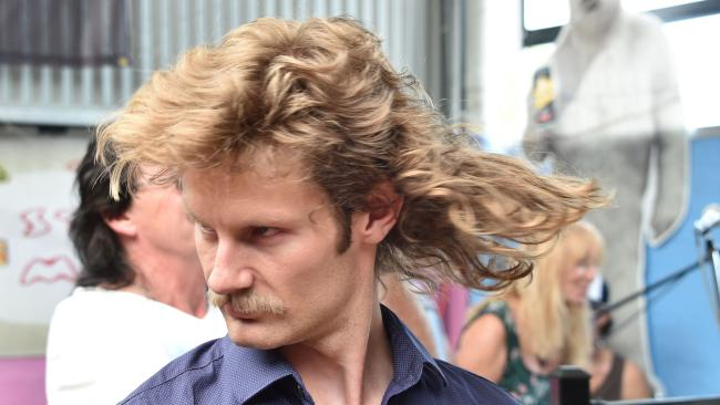 Strike a pose: A man shows off his mullet haircut at Mulletfest 2018 at Kurri Kurri. Picture: AFP/Peter Parks
