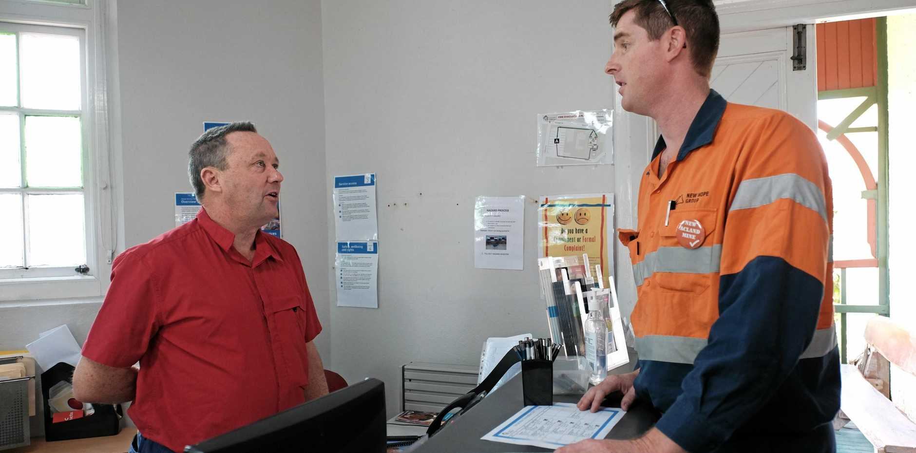 TARGET SMASHED: Toowoomba Clubhouse member Anthony Rooney (left) chats with New Acland Mine operations manager Dave O'Dwyer.