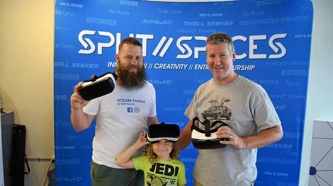 Jarryd Townson from Split Spaces (left) and Mackensie and Warwick Hays with the VR headsets.