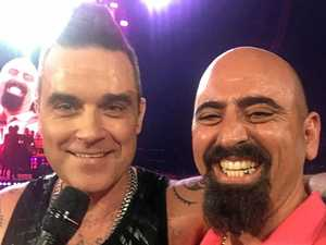 Mackay man on stage with Robbie Williams in Melbourne
