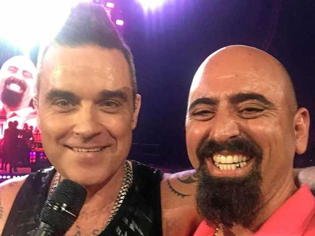 World superstar Robbie Williams with Mackay born and bred man Justin Shepherd.