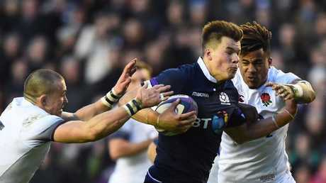 Centre Huw Jones runs in Scotland's third try at Murrayfield.