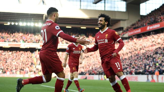 Liverpool's Egyptian midfielder Mohamed Salah (R) celebrates with Alex Oxlade-Chamberlain