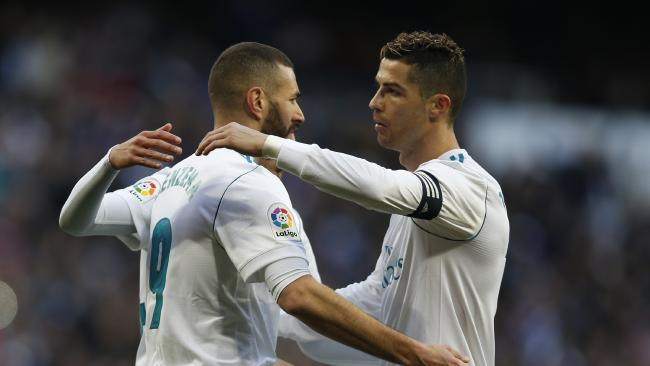 Real Madrid's Karim Benzema, left, celebrates with teammate Cristiano Ronaldo