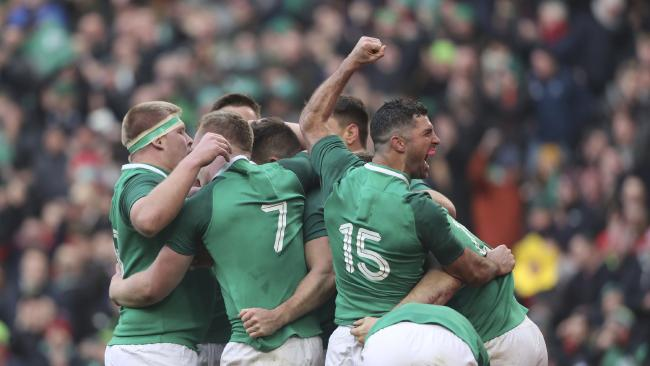 Ireland celebrates Jacob Stockdale's try to secure the win against Wales.