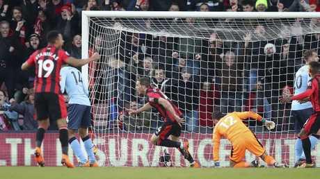 Bournemouth's Dan Gosling, centre, celebrates scoring his side's second goal