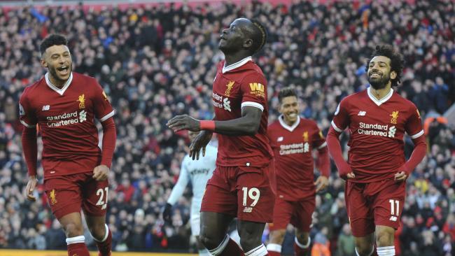 Liverpool's Sadio Mane, centre, celebrates scoring his sides fourth goal