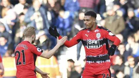 Huddersfield Town's Steve Mounie, right, celebrates scoring