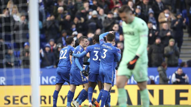 Leicester City's Jamie Vardy, centre, celebrates his side's first goal of the game with team mates after Stoke City goalkeeper Jack Butland, right, scored an own-goal