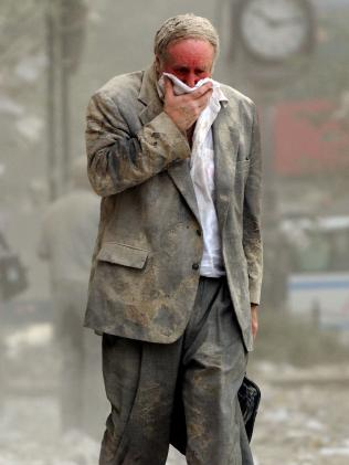 Edward Fine covers his mouth as he walks through the debris after the collapse of one of the World Trade Centre in New York. Picture: AFP/Stan Honda