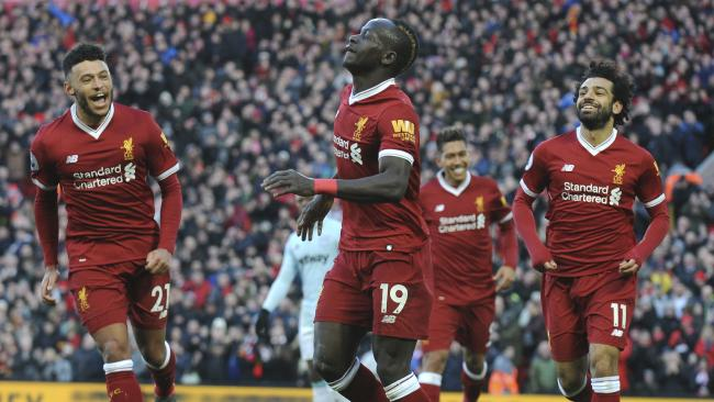 Liverpool's Sadio Mane, centre, celebrates scoring his sides fourth goal during the English Premier League soccer match between Liverpool and West Ham United at Anfield in Liverpool, England, Saturday, Feb. 24, 2018. (AP Photo/Rui Vieira)