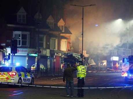 Members of the emergency services at the scene of the explosion in Leicester. A 'major incident' has been declared by police after reports of an explosion in Leicester in which four people have been taken to Leicester Royal Infirmary hospital. EPA/TIM KEETON