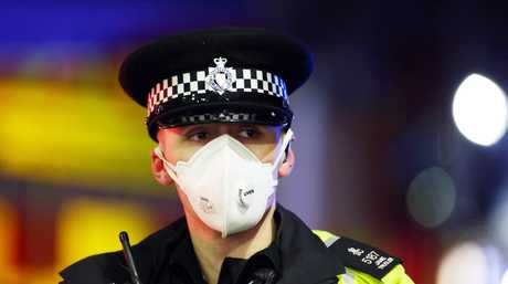 A Leicestershire policeman wearing a face mask at the scene of the explosion which destroyed a property in Leicester UK. A 'major incident' has been declared by police.