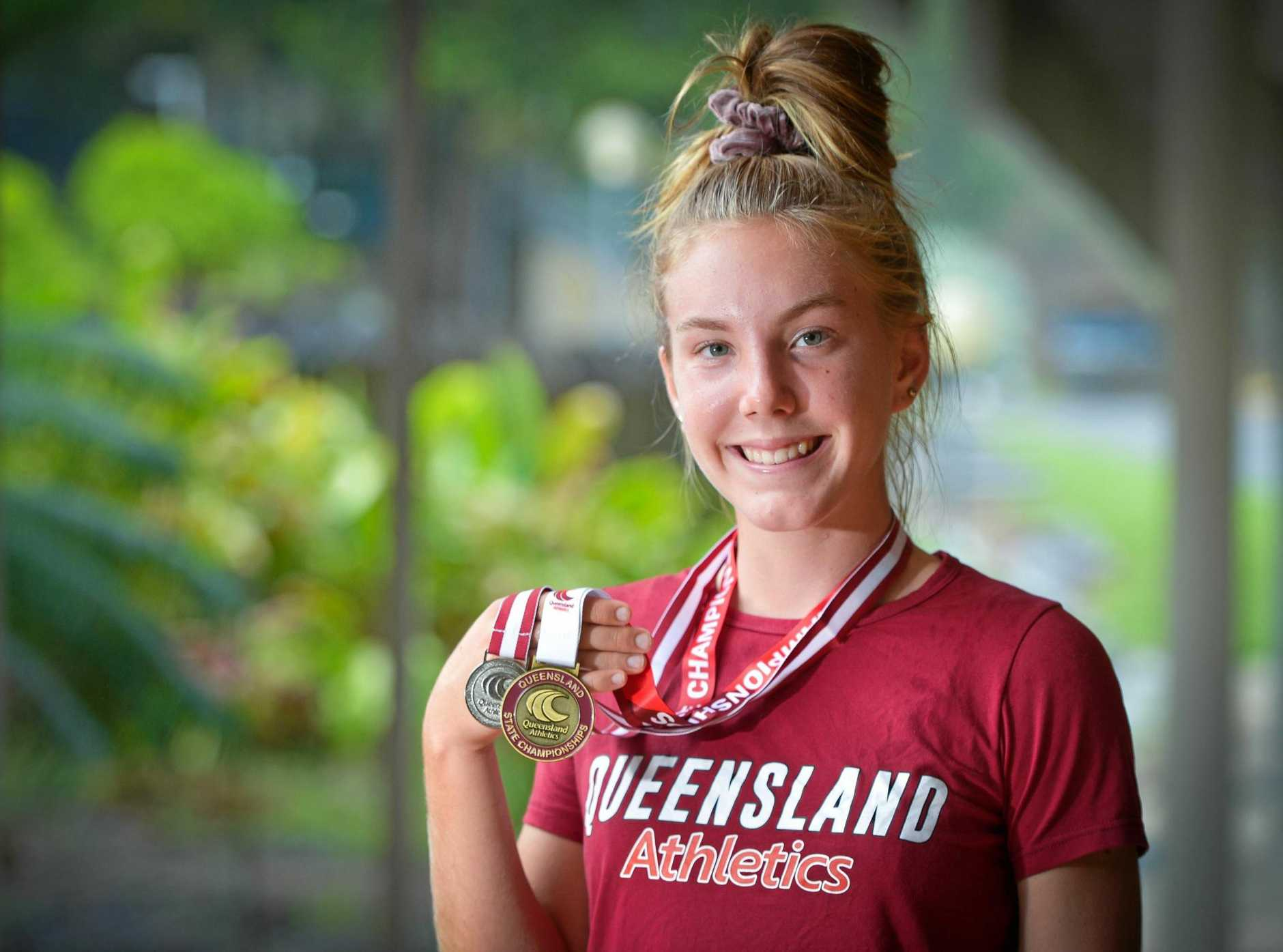 TOUGH DUFF: Sophie Duff won gold in the under-15 girl's triple jump at the Queensland Junior Athletics Championships in Brisbane last weekend.