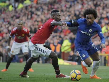 Chelsea's Willian, right, challenges for the ball with Manchester United's Paul Pogba