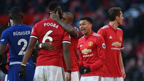 Manchester United's English midfielder Jesse Lingard (2nd R) and teammates celebrate on the pitch after the English Premier League football match