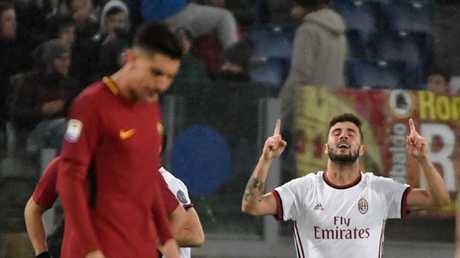 AC Milan's Italian forward Patrick Cutrone celebrates