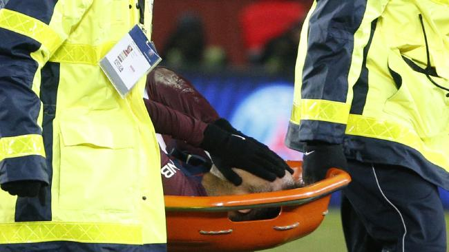 Paris Saint-Germain's Brazilian forward Neymar Jr is evacuated on a stretcher during the French L1 football match between Paris Saint-Germain (PSG) and Marseille