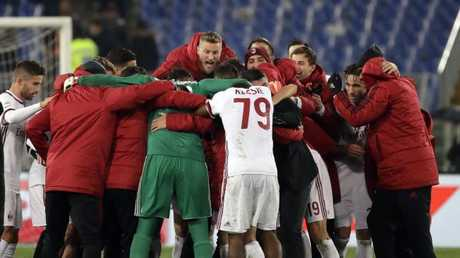 AC Milan players celebrate their 2-0 win