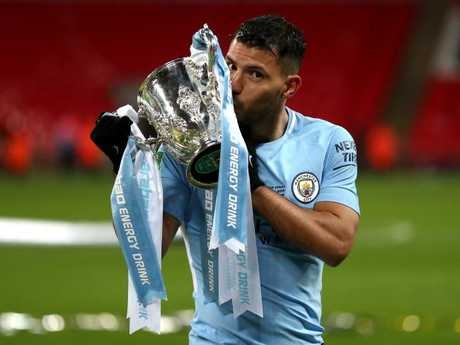Sergio Aguero of Manchester City kisses the trophy