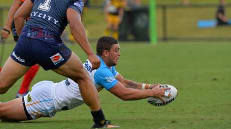 Ash Taylor scores a try for the Titans against the Warriors.