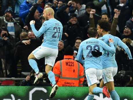 Manchester City's Spanish midfielder David Silva (L) celebrates