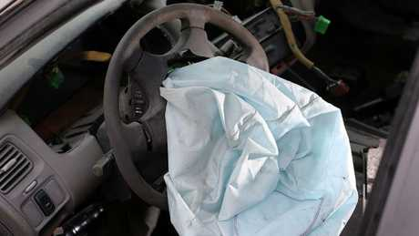 A deployed airbag is seen in a 2001 Honda Accord in the US. Picture: Joe Raedle/Getty Images/AFP.