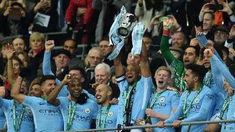 Manchester City's Belgian defender Vincent Kompany lifts the trophy