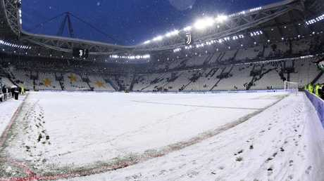 The snow blanketed pitch of the Allianz Stadium in Turin, Italy.