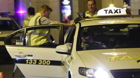 RMS inspectors make routine checks of taxis at Star City Casino in Sydney. Picture: Gordon McComiskie