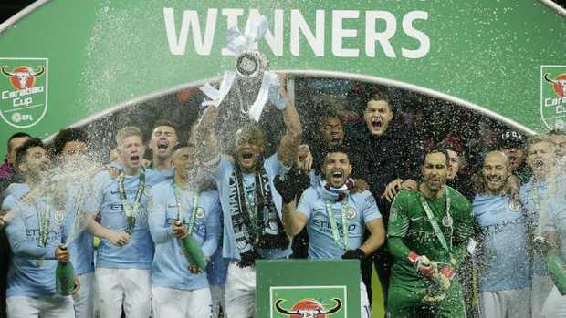Manchester City's Vincent Kompany, centre lifts the English League Cup