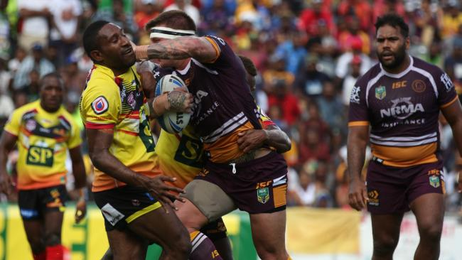 Josh McGuire on the charge for the Broncos against PNG Hunters.
