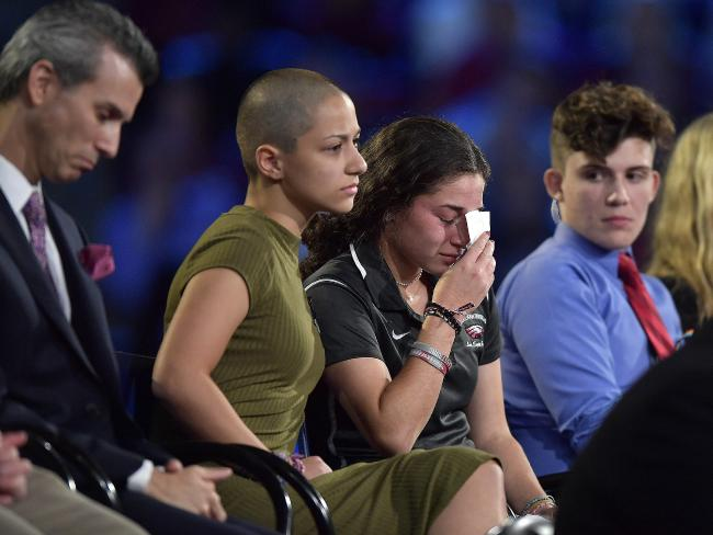 Marjory Stoneman Douglas High School student Emma Gonzalez comforts a classmate during a CNN town hall meeting.