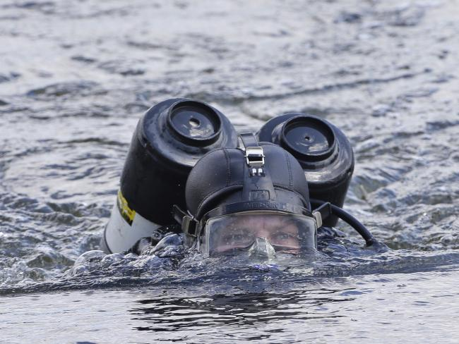 Police divers found parts of Mr Bernard's body in the Maribyrnong River. Picture: Hamish Blair