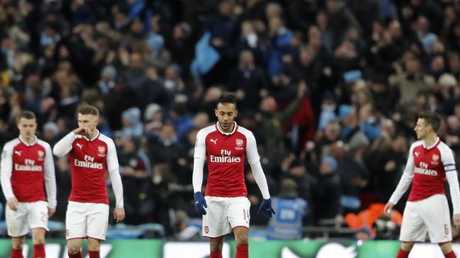 Arsenal's Pierre-Emerick Aubameyang, center, reacts