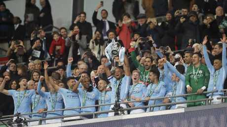 Manchester City's Vincent Kompany lifts the trophy