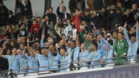 Manchester City's Vincent Kompany lifts the trophy