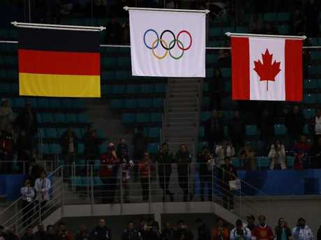 The Olympic flag was raised instead of the Russian flag. (Photo by Ronald Martinez/Getty Images)